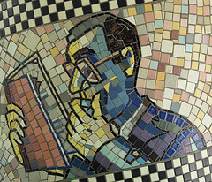 man-reading-book-mosaic.jpg