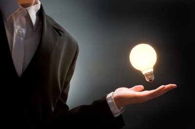 Man light bulb in hand.jpg